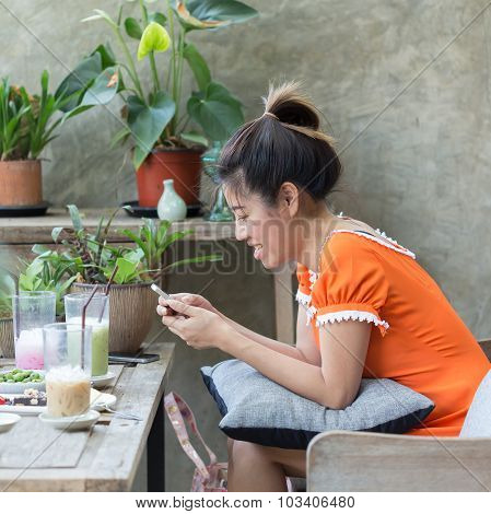 Women Lifestyle Using A Mobile Phone In Cafe Coffee Shop With Texting Message On App Smartphone Play