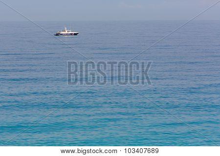 Coast guard boat on calm sea water