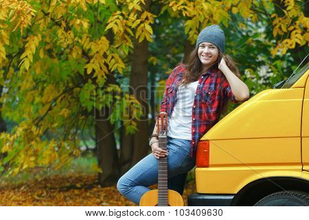 Autumn Portrait Of Pretty Guitarist Girl Travelling By Yellow Minibus