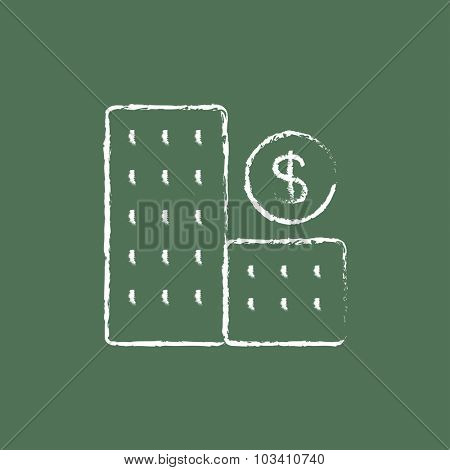 Condominium with dollar symbol hand drawn in chalk on a blackboard vector white icon isolated on a green background.