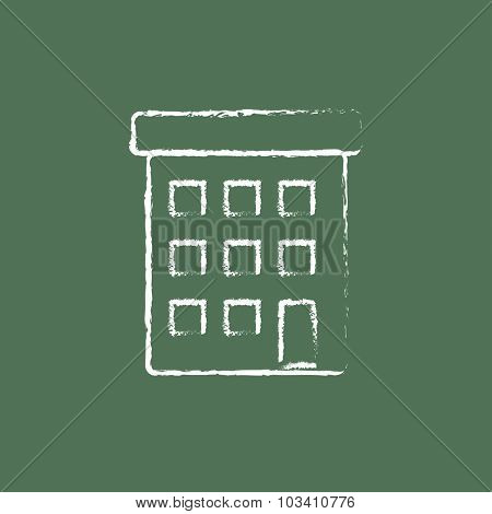 Condominium building hand drawn in chalk on a blackboard vector white icon isolated on a green background.
