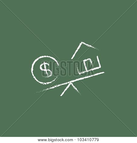 House and dollar symbol on scales hand drawn in chalk on a blackboard vector white icon isolated on a green background.