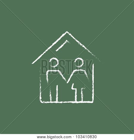 Family house hand drawn in chalk on a blackboard vector white icon isolated on a green background.