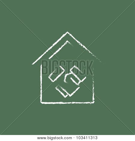 Handshake and successful real estate transaction hand drawn in chalk on a blackboard vector white icon isolated on a green background.