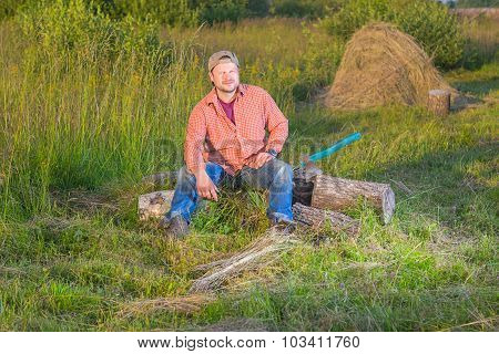Farmer with an axe sitting