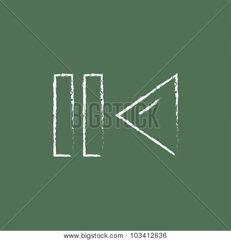 Pause and playback button hand drawn in chalk on a blackboard vector white icon isolated on a green background.