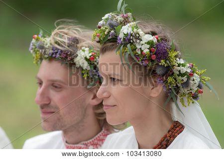 Newlyweds In Wreaths