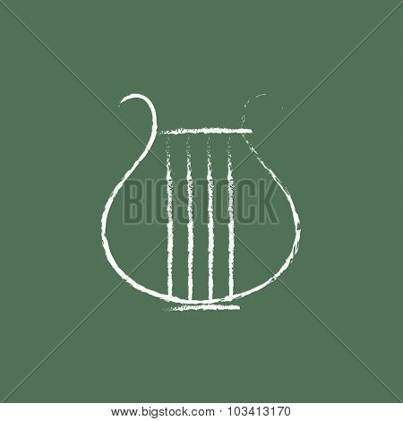 Lyre hand drawn in chalk on a blackboard vector white icon isolated on a green background.