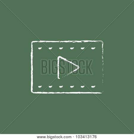 Film frame hand drawn in chalk on a blackboard vector white icon isolated on a green background.