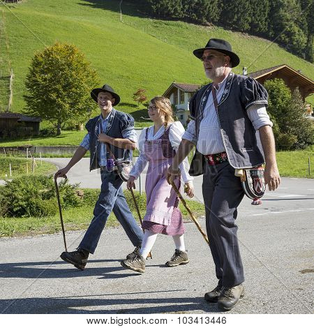 CHARMEY SWITZERLAND - SEPTEMBER 26 2015: herdsman and woman on the annual transhumance at Charmey on the Swiss alps.