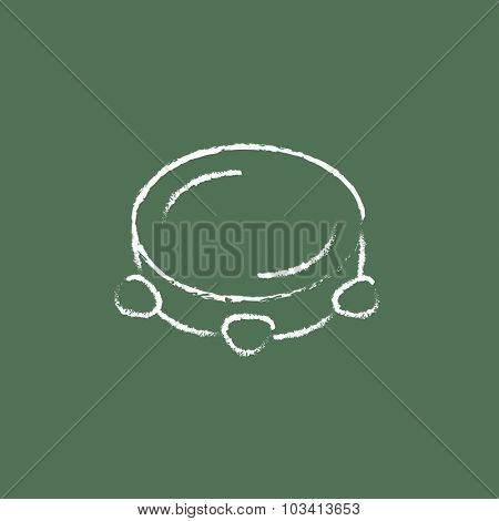 Tambourine hand drawn in chalk on a blackboard vector white icon isolated on a green background.