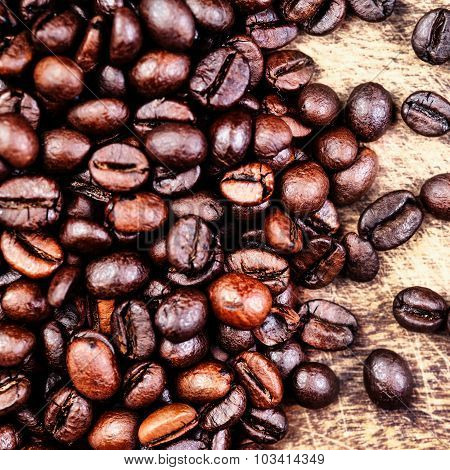 Coffee Beans On A Grunge Wooden Background Close Up