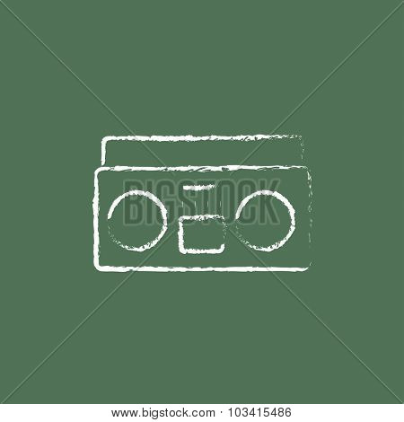Cassette player hand drawn in chalk on a blackboard vector white icon isolated on a green background.
