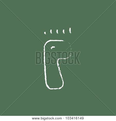 Footprint hand drawn in chalk on a blackboard vector white icon isolated on a green background.