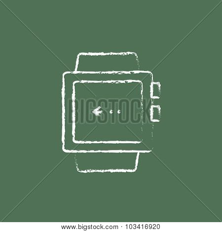 Smartwatch hand drawn in chalk on a blackboard vector white icon isolated on a green background.