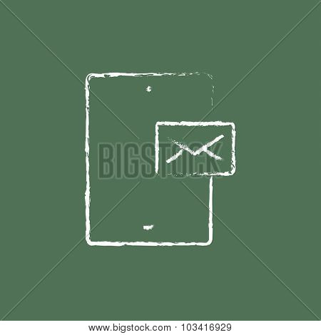 Touch screen phone with message hand drawn in chalk on a blackboard vector white icon isolated on a green background.
