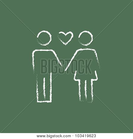 Couple in love hand drawn in chalk on a blackboard vector white icon isolated on a green background.