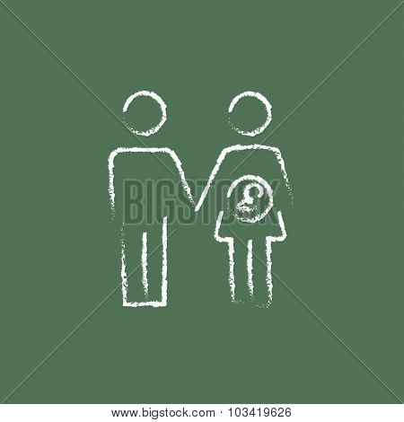 Husband with pregnant wife hand drawn in chalk on a blackboard vector white icon isolated on a green background.
