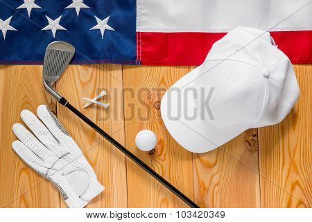 Equipment For Golf And An American Flag On A Wooden Floor View From Above
