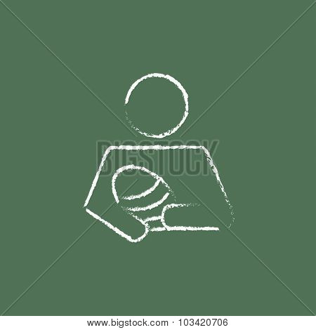 Nurse holding the baby hand drawn in chalk on a blackboard vector white icon isolated on a green background.