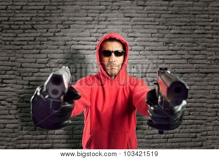 Robber Pointing Two Guns
