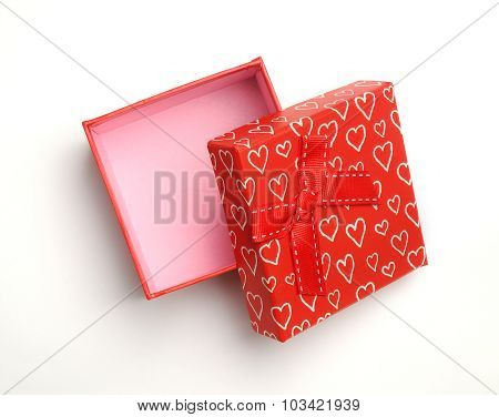 Open Red Gift With Bow And Painted Hearts Isolated Top