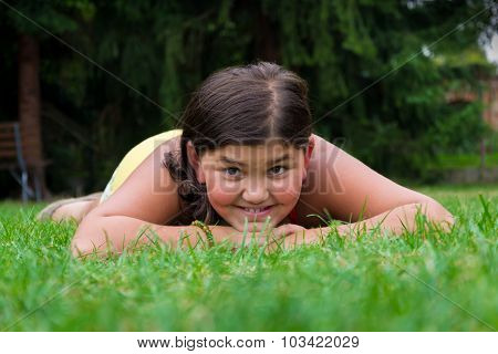 Young Girl Gypsy Child Smiling In Grass Laying