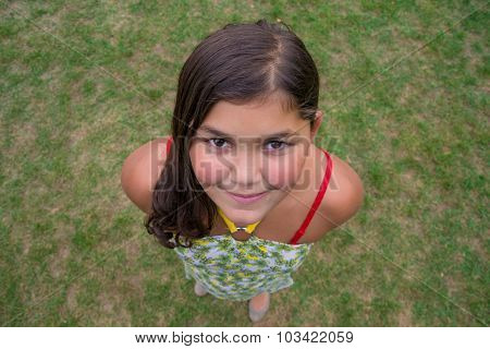 Child Face Smiling Girl Shot From Above Perspective In Grass