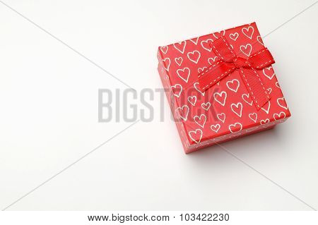 Red Gift Box With Bow And Hearts Isolated Perspective Top