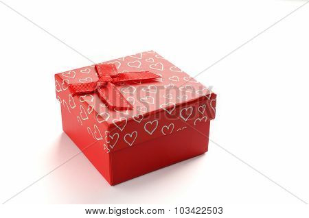 Red Gift Box With Bow And Painted Hearts Isolated