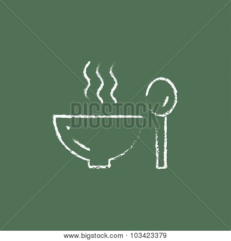 Bowl of hot soup with spoon hand drawn in chalk on a blackboard vector white icon isolated on a green background.