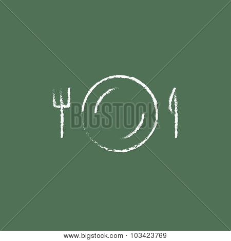 Plate with cutlery hand drawn in chalk on a blackboard vector white icon isolated on a green background.