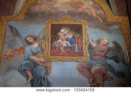 LJUBLJANA, SLOVENIA - JUNE 30: Virgin Mary with baby Jesus, fresco in the Franciscan Church of the Annunciation in Ljubljana, Slovenia on June 30, 2015