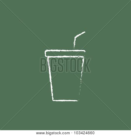 Disposable cup with lid and drinking straw hand drawn in chalk on a blackboard vector white icon isolated on a green background.