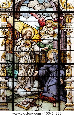 ZAGREB, CROATIA - MAY 28: Jesus and Saint Margaret Mary Alacoque, stained glass window in the Basilica of the Sacred Heart of Jesus in Zagreb, Croatia on May 28, 2015