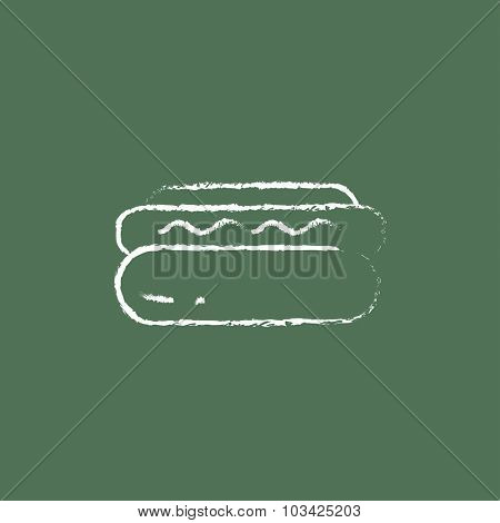 Hotdog hand drawn in chalk on a blackboard vector white icon isolated on a green background.