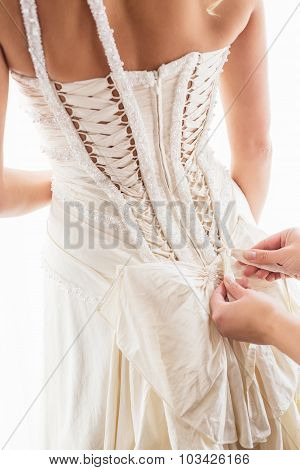 Helping bride with a dress