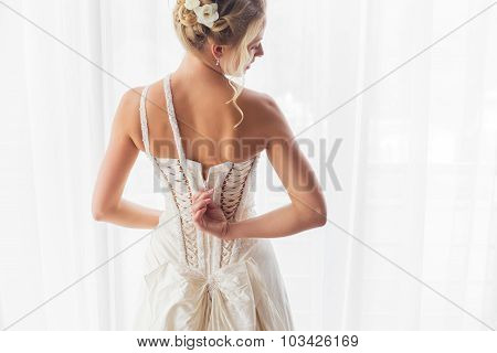 Bride opening her wedding dress