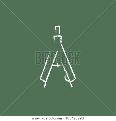 Compass hand drawn in chalk on a blackboard vector white icon isolated on a green background.