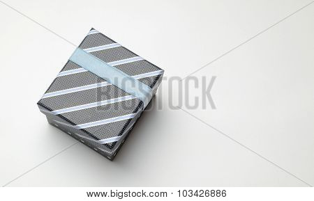 Black Gift Box With Ribbon And Blue Lines Top Perspective