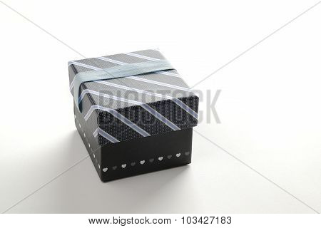 Black Gift Box With Ribbon And Blue Lines