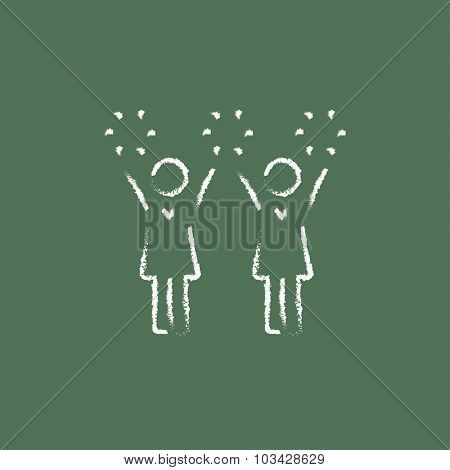 Cheerleaders hand drawn in chalk on a blackboard vector white icon isolated on a green background.