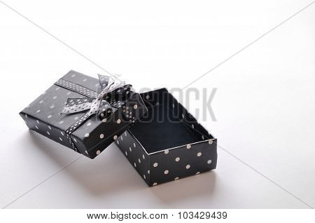 Small Open Black Gift Box With Ribbon And Circles