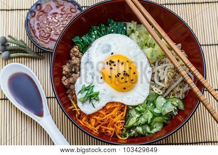 bibimbap in a bowl, korean dish top view