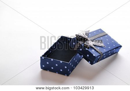 Small Open Blue Gift Box With Ribbon And Circles