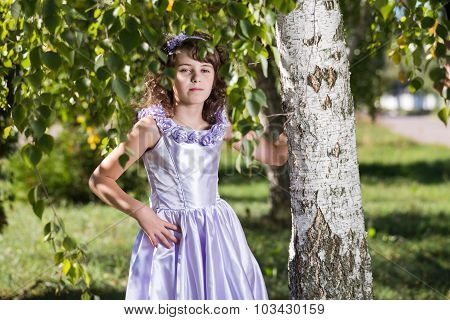 Girl Stands Near The Birch.