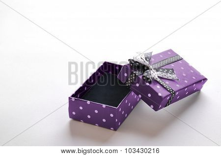 Small Open Purple Gift Box With Ribbon And Circles