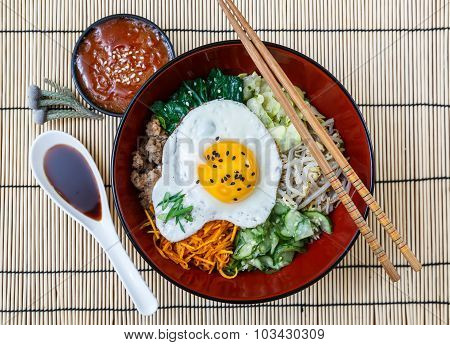 bibimbap in a bowl, korean dish from top.