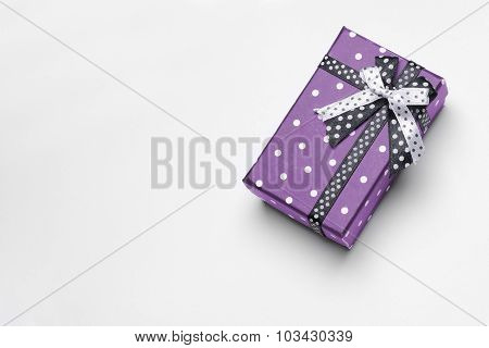 Small Purple Gift Box With Ribbon And Circles Top