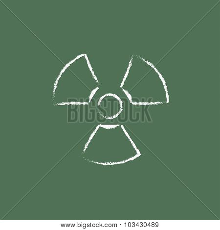 Ionizing radiation sign hand drawn in chalk on a blackboard vector white icon isolated on a green background.